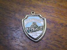 Vintage silver WYOMING STATE DEVILS TOWER ENAMEL TRAVEL SHIELD charm #E9