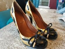 BCBGMAXAZRIA Round Toe Bronze Gold Pumps with Black Tie Bow Size 6.5