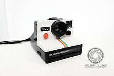 Vintage Polaroid 1000 Instant Film Camera with neck strap