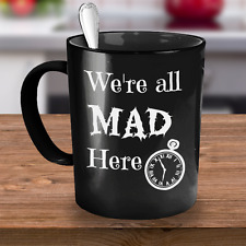 Alice in Wonderland coffee mug with fun saying, We're All Mad Here