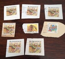 Assorted Stamps from Singapore - unsoaked on paper