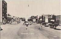 South Dakota SD Real Photo RPPC Postcard c1950 CANISTOTA Main Street Stores Cars