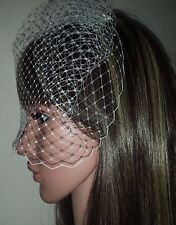 "Brides Ivory birdcage wedding veil 9"" Veil is attached to metal comb. Fascinator"