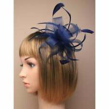 Navy blue fascinator with sinamay loops and feather tendrils set on hair comb.