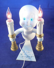 CASPAR THE GHOST LIGHT 1995 HOLDS TWO FLICKERING FLAMES AND HIS EYES LIGHT BLUE