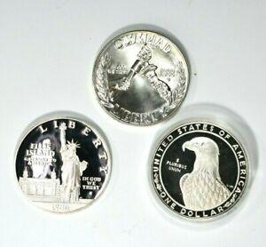Lot of 3 $1 Commemorative Proof Silver Dollars Olympics and Ellis Island 99c NR