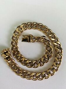 9CT YELLOW GOLD CHUNKY CURB LINKED BRACELET - 8.25 INCHES