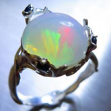 Anelli di lusso con gemme multicolore cabochon opale