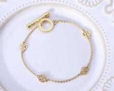 Tory Burch Gold Logo Bracelet.