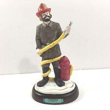 Porcelain hand-signed Emmett Kelly Jr Fireman Figure, Flambro Exclusive
