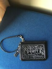 COACH POPPY BLACK PATENT LEATHER WRISTLET WITH FUNKY SILVER WRITING AND HANG TAG