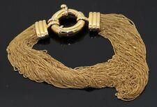 Heavy 18K gold high fashion multi-strand chain bracelet