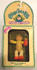 VINTAGE 1984 MINIATURE PVC CABBAGE PATCH KIDS DOLL FIGURE HOLDING A BABY.