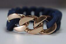 pulsera elástica acero y silicona azul , oro cobrizo  eslabón barbado ,  24h Esp