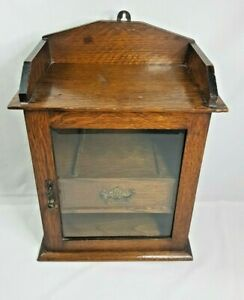 VINTAGE SMOKERS PIPE CABINET WITH KEY, MISSING THE JAR.