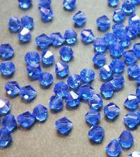 40 perles en verre à facettes toupies 4mm bleu océan