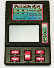 Portable Slots Hand Held Electronic Game. Great Condition. Batteries included.