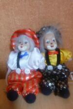 Lot de 2 clowns en porcelaine sur balançoire a suspendre