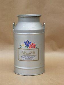 Boite ancienne chocolat Lindt pot à lait en tole métal publicitaire vintage