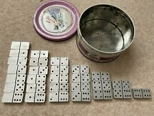 Set of vintage aluminium Dominoes in old tin