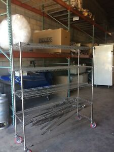 """metro shelving 60"""" x 18"""" x 67"""" tall  stainless steel on wheels"""