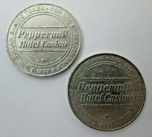 2 Vintage Peppermill Hotel Casino $1 Metal Chips 1992 1995 WORN and WELL USED
