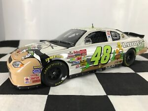 AUTOGRAPHED 1:24 Jimmie Johnson #48 Looney Tunes Rematch 2002 Chevy #557C of 833
