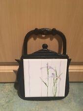 Lanka Walltiles ceramic square flower trivet With Cast Iron Pot Background