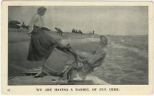 1910 Women in Dresses See-Saw on a Barrel at the Beach Postcard