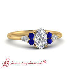 .75 Ctw Oval Shape FLAWLESS Diamond And Sapphire 7 Stone Tapered Engagement Ring
