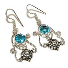 silver plated Handmade Designer Earrings Faceted Swiss Blue Topaz Round Gemstone