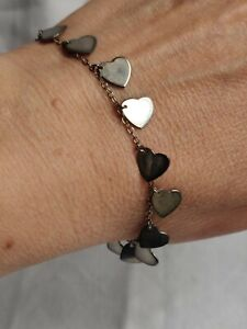 Vintage sterling silver bracelet with small hearts