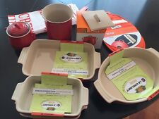 LE Creuset  lot of 9 misc items-baking dishes, utensil holder, towel, pot holder