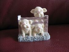 Three Pigs stuck in a fence ornament. No brand.