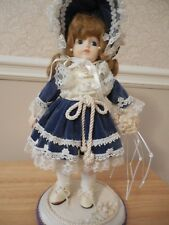 Petitie Modern Porcelain Doll with Designer Hand Made Clothing - One of a Kind