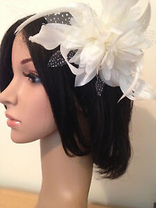 SILVER POLKA DOT MESH FLOWER & FEATHER FASCINATOR ON A Comb