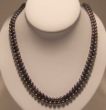 Brand New hand strung 6mm black round fresh water cultured Pearl necklace.