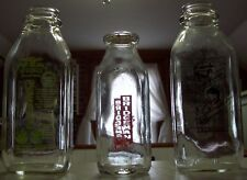 3 DIFFERENT GLASS MILK BOTTLES.  2 QUARTS 1 PINT.  ONE WITH ORIGINAL LID/STOPPER