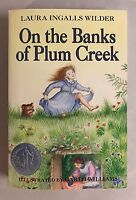 On The Banks Of Plum Creek by Laura Ingalls Wilder Paperback Book