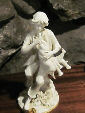 Nuova Capodimonte white porcelain courting boy with bagpipe gold painted base