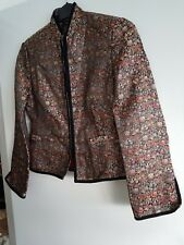 beautiful multi colour jacket with red lining. hook & eye on sleeves and front.