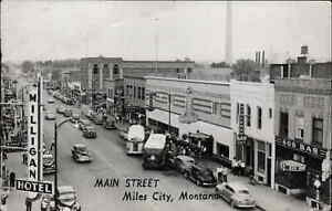 Miles City MT Main St. Store Signs Cars Bus Real Photo Postcard