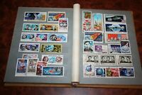 Postage stamps in an old vintage album. Space Transport Sports