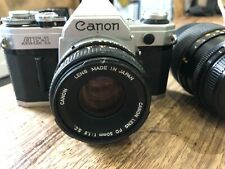 Canon AE-1 35mm SLR Film Camera with FD 50mm Lens and Additional Lens
