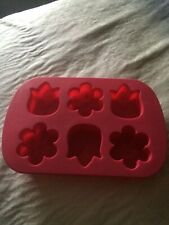 silcone flower molds in flexible silicone bakesafe tray.