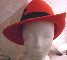 Tally-Ho red felt ladies hat with black ribbon band and feather on one side