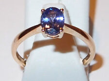 Classic Tanzanite solitaire (oval, 1.00ct) 9K Yellow Gold ring, Size O.