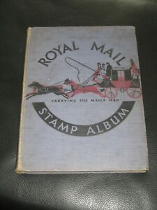 blue royal mail stamp album with world stamps