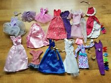 Lot Of Barbie Clothes And Shoes