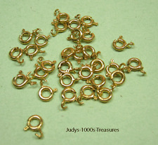 14k SOLID YELLOW GOLD SPRING RINGS 5mm. AVERAGE 0.15gr. STAMPED 14k